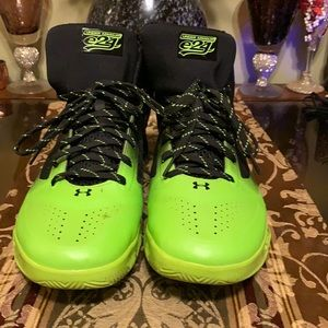 Excellent condition men  neon green and black size 12 Under Armor sneakers.